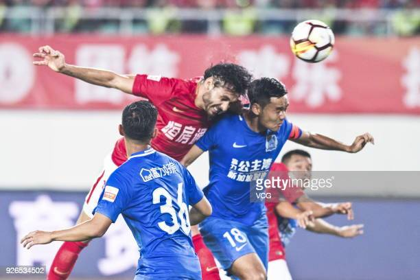 Ricardo Goulart of Guangzhou Evergrande jumps to head the ball during the 2018 Chinese Football Association Super League first round match between...