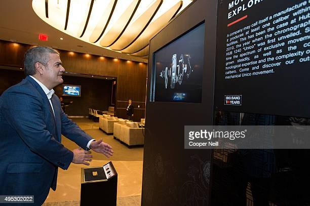 Ricardo Guadalupe interacts with the Hublot display as Hublot unveils the Big Bang Dallas Cowboys timepieces at ATT Stadium on November 1 2015 in...