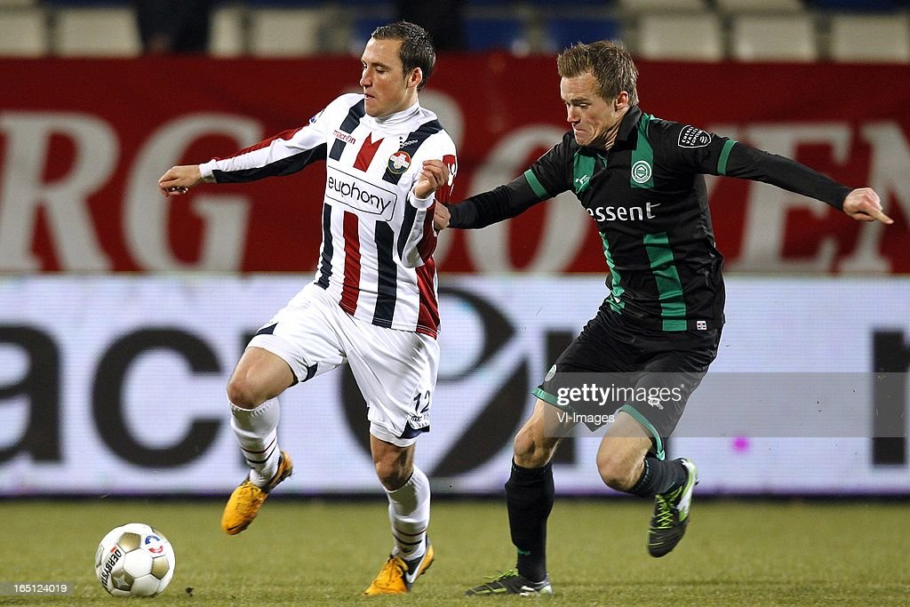 Ricardo Ippel of Willem II (L), Maikel Kieftenbeld of FC Groningen (R) during the Dutch Eredivisie match between Willem II and FC Groningen at the Koning Willem II Stadium on march 30, 2013 in Tilburg, The Netherlands