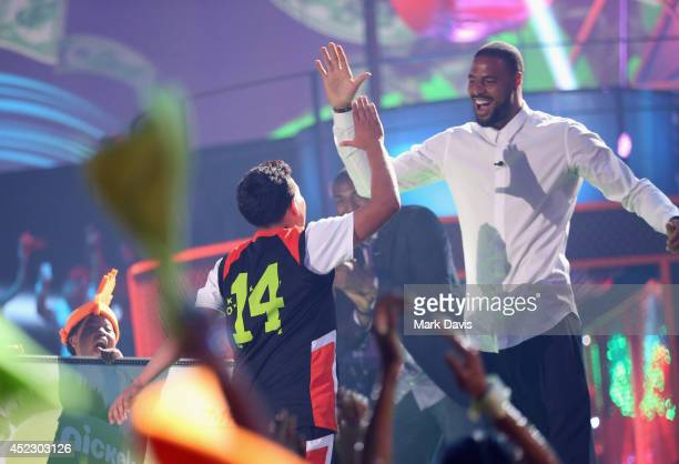 Ricardo Jacobo Jr and NBA player Tyson Chandler speak onstage during Nickelodeon Kids' Choice Sports Awards 2014 at UCLA's Pauley Pavilion on July 17...