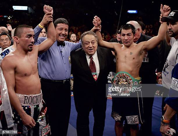 Ricardo Juarez referee Raul Caiz Sr WBC president Jose Sulaiman and Marco Antonio Barrera of Mexico pose together after the WBC World Championship...
