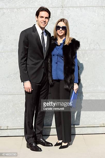 Ricardo Kaka and Carolina Celico attend the Giorgio Armani show during the Milan Fashion Week Womenswear Autumn/Winter 2014 on February 24 2014 in...