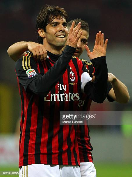 Ricardo Kaka of AC Milan celebrates his goal with his teammate Adel Taarabt during the Serie A match between AC Milan and AC Chievo Verona at San...