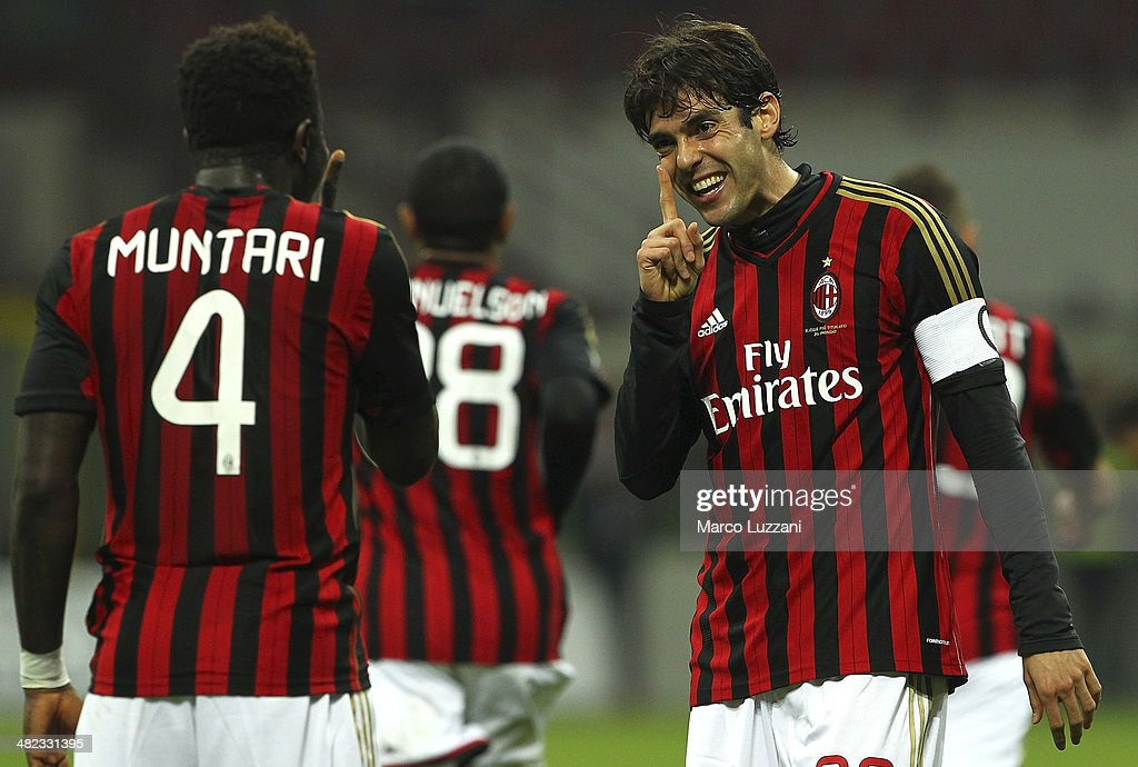 Ricardo Kaka (R) of AC Milan celebrates his goal with his team-mate Sulley Ali Muntari (L) during the Serie A match between AC Milan and AC Chievo Verona at San Siro Stadium on March 29, 2014 in Milan, Italy.