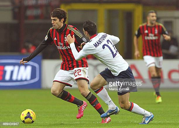 Ricardo Kaka of AC Milan competes for the ball with Andrea Mantovani of Bologna FC during the Serie A match between AC Milan and Bologna FC at San...