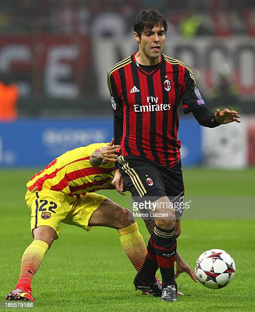 Ricardo Kaka of AC Milan competes for the ball with Daniel Alves of FC Barcelona during the UEFA Champions League Group H match between AC Milan and...
