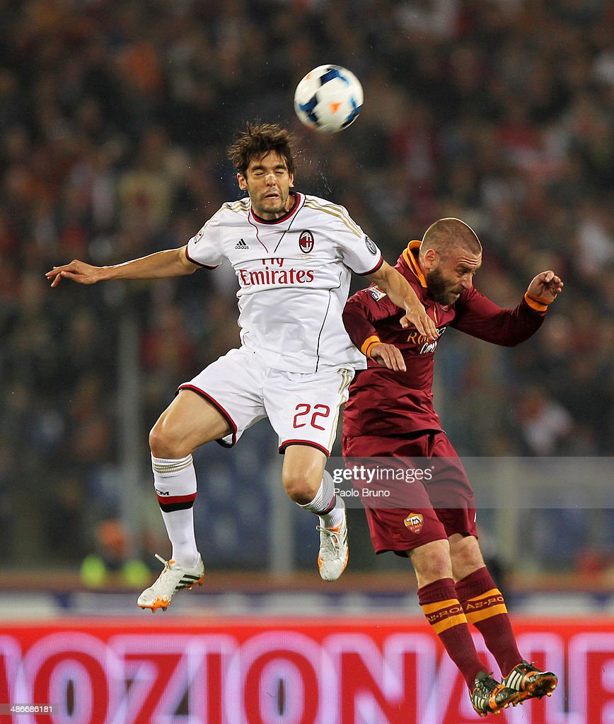 Ricardo Kaka' (L) of AC Milan competes for the ball with Daniele De Rossi of AS Roma during the Serie A match between AS Roma and AC Milan at Stadio Olimpico on April 25, 2014 in Rome, Italy.