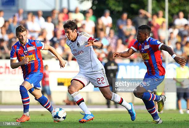Ricardo Kaka of AC Milan competes for the ball with Dragan Mihajlovic and Joaquim Adao of Chiasso during the friendly match between Chiasso and AC...