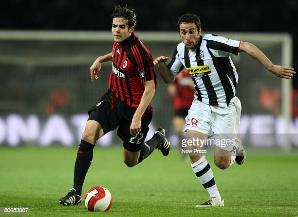 Ricardo Kaka of Milan and Cristian Molinaro of Juventus in action during the Serie A match between Juventus and Milan at the Stadio Olimpico on April...