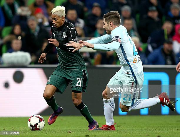 Ricardo Laborde of FC Krasnodar is challenged by Javi Garcia of FC Zenit St Petersburg during the Russian Premier League match between FC Krasnodar v...