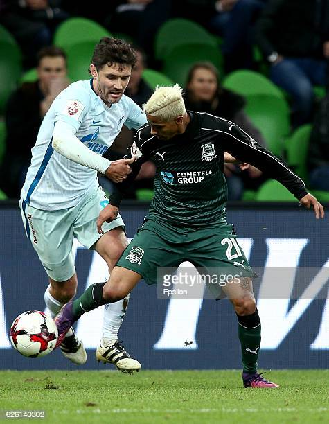 Ricardo Laborde of FC Krasnodar is challenged by Yuri Zhirkov of FC Zenit St Petersburg during the Russian Premier League match between FC Krasnodar...