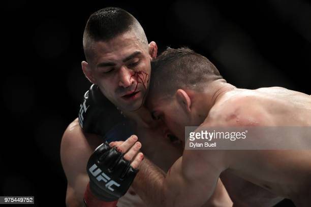 Ricardo Lamas grapples with Mirsad Bektic of Bosnia in the second round in their featherweight bout during the UFC 225 Whittaker v Romero 2 event at...