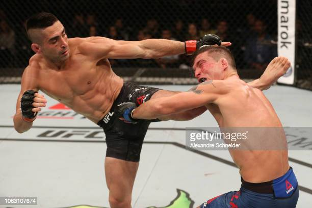 Ricardo Lamas kicks Darren Elkins in their featherweight bout during the UFC Fight Night event inside Arena Parque Roca on November 17 2018 in Buenos...
