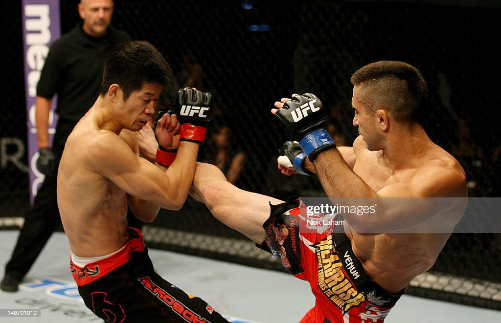 Ricardo Lamas kicks Hatsu Hioki in a featherweight bout during UFC