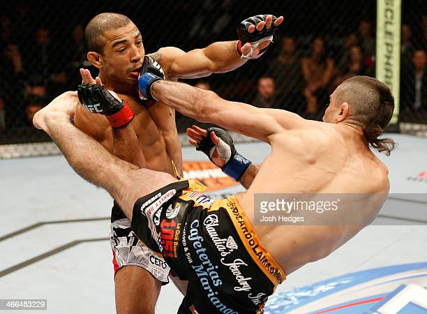 Ricardo Lamas kicks Jose Aldo in their featherweight championship fight at the UFC 169 event inside the Prudential Center on February 1 2014 in...