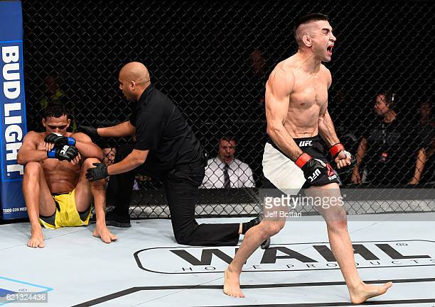 Ricardo Lamas of the United States celebrates his submission victory over Charles Oliveira of Brazil in their featherweight bout during the UFC Fight...