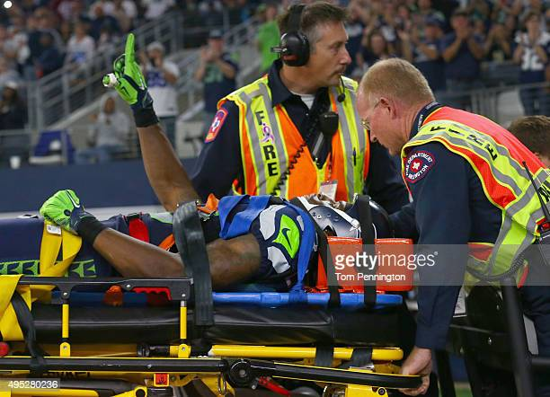 Ricardo Lockette of the Seattle Seahawks waves to fans while being carted off the field in the second quarter at ATT Stadium on November 1 2015 in...