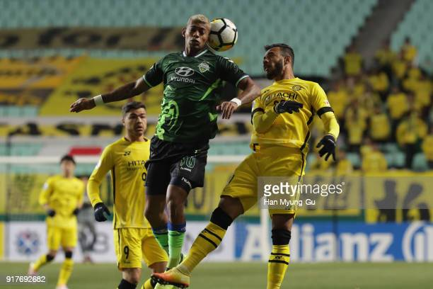 Ricardo Lopes of Jeonbuk Hyundai Motors and Ramon Lopes of Kashiwa Reysol compete for the ball during the AFC Champions League Group E match between...