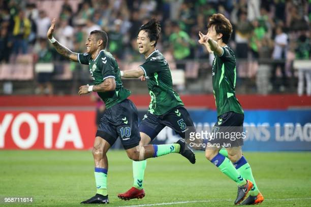 Ricardo Lopes of Jeonbuk Hyundai Motors celebrates scoring the opening goal with his team mates during the AFC Champions League Round of 16 second...