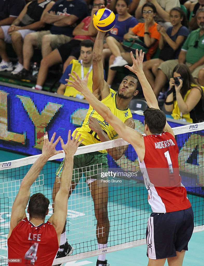 Ricardo Lucarelli of Brazil spikes the ball as Matthew Anderson and David Lee of United States blocks during the FIVB World League Final Six match for the first place between United States and Brazil at Mandela Forum on July 20, 2014 in Florence, Italy.