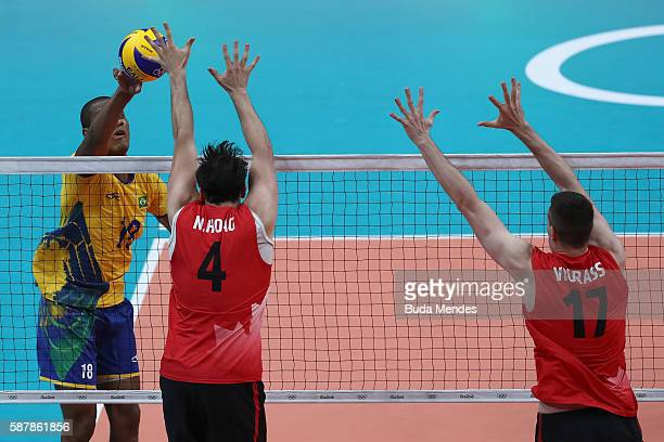 Ricardo Lucarelli of Brazil spikes the ball during the men's qualifying volleyball match between the Brazil and Canada on Day 4 of the Rio 2016...