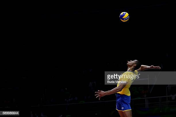 Ricardo Lucarelli of Brazil spikes the ball during the men's qualifying volleyball match between Brazil and France on Day 10 of the Rio 2016 Olympic...