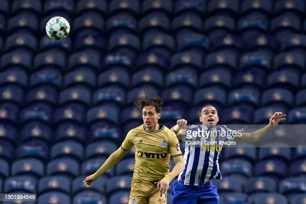 Ricardo Mangas of Boavista FC competes for the ball with Kepler Lima 'Pepe' of FC Porto during the Liga NOS match between FC Porto and Boavista FC at...