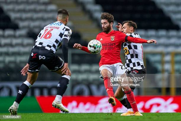 Ricardo Mangas of Boavista FC competes for the ball with Rafa Silva of SL Benfica during the Liga NOS match between Boavista FC and SL Benfica at...