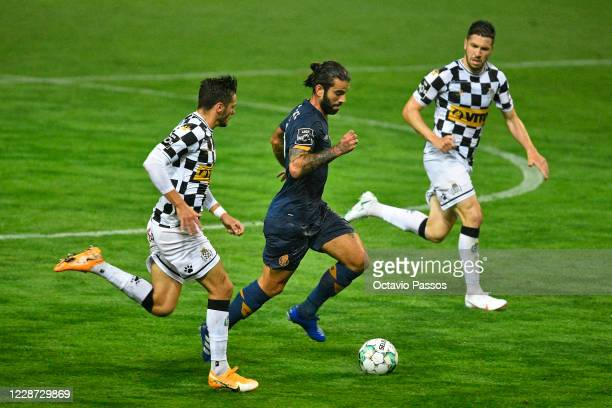 Ricardo Mangas of Boavista FC competes for the ball with Sergio Oliveira of FC Porto during the Liga NOS match between Boavista FC and FC Porto at...