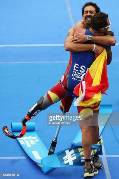 Ricardo Marin Arces of Spain celebrates with Raul Zambrana Romero of Spain after winning the Paratriathlon Male Tri-2 race on October 22, 2012 in...