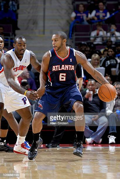 Ricardo Marsh of the Atlanta Hawks handles the ball against DaJuan Summers of the Detroit Pistons during the preseason game on October 11 2010 at The...