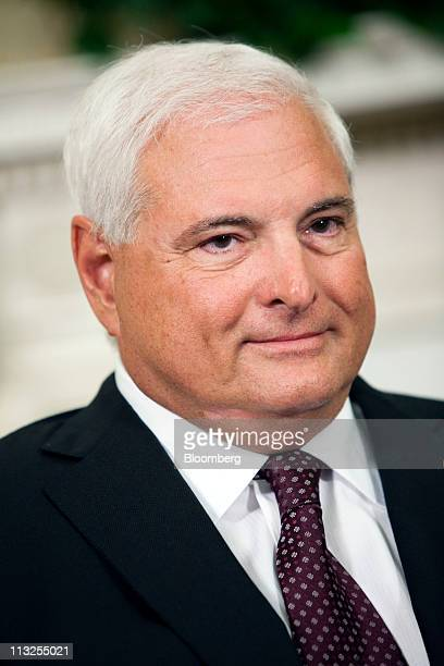 Ricardo Martinelli president of Panama listens as US President Barack Obama talks to reporters after their meeting in the Oval Office at the White...