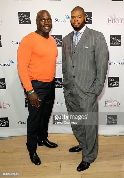 Ricardo McDonald and Wade Smith walk the runway at the Saks Fifth Avenue And Off The Field Players' Wives Association Charitable Fashion Show on...