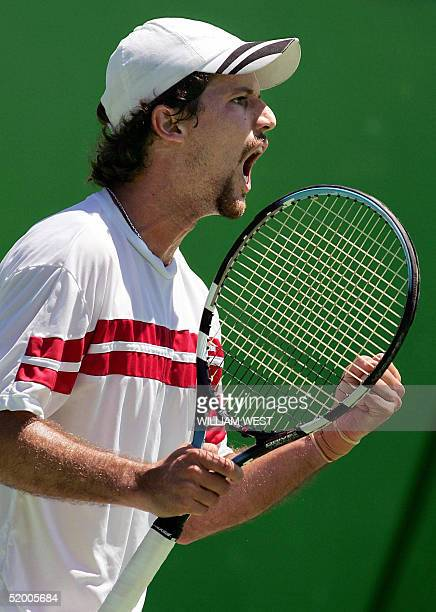 Ricardo Mello of Brazil celebrates a point against Alberto Martin of Spain in their men's singles first round match at the Australian Open tennis...