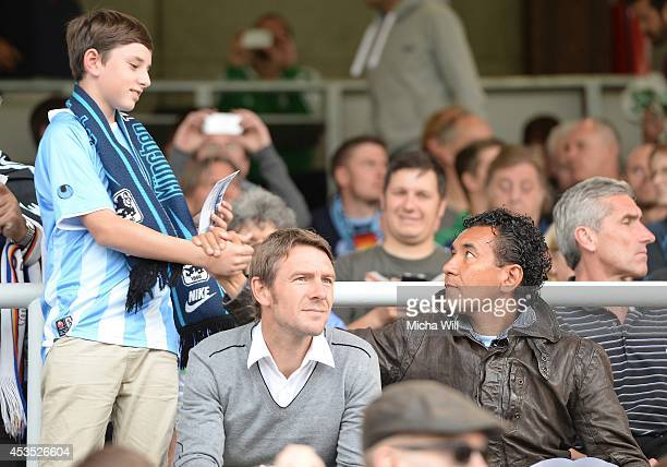 Ricardo Moniz head coach of the professional soccer team of TSV 1860 Muenchen high fives with a young boy prior to the Regionalliga match between TSV...