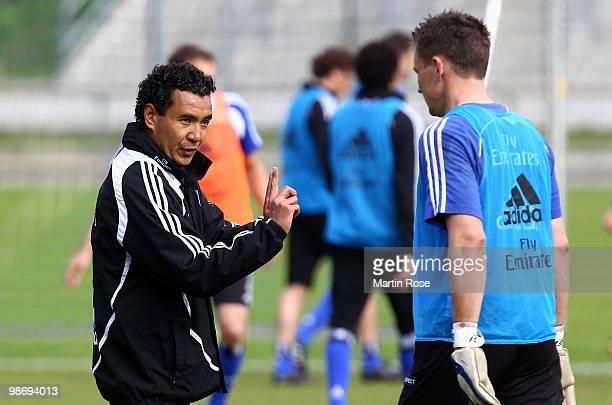 Ricardo Moniz interim coach of Hamburg talks to goalkeeper Frank Rost during the Hamburger SV training session at HSH Nordbank Arena on April 27 2010...