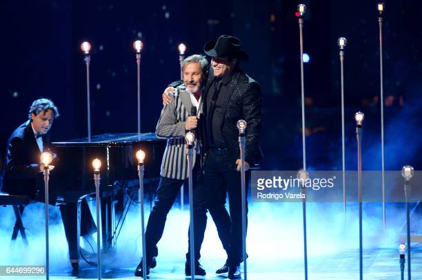 Ricardo Montaner and Julion Alvarez perform onstage during Univision's 29th Edition of Premio Lo Nuestro A La Musica Latina at the American Airlines...