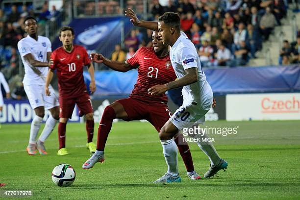Ricardo of Portugal and Liam Moore of England vie for the ball during the UEFA Under21 European Championship 2015 football match between England and...