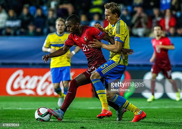 Ricardo of Portugal battles for the ball with Ludwig Augustinsson of Sweden during UEFA U21 European Championship Group B match between Portugal and...