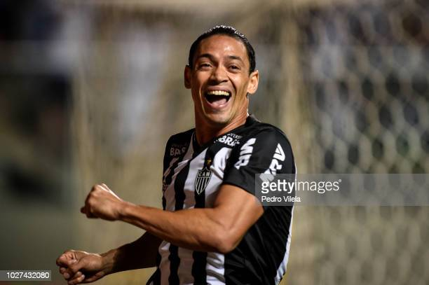 Ricardo Oliveira of Atletico MG celebrates after Regis of Sao Paulo scores an own goal during a match between Atletico MG and Sao Paulo as part of...