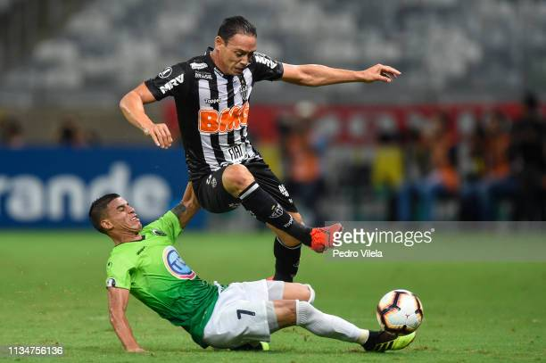 Ricardo Oliveira of Atletico MG struggles for the ball with Pedro Ramírez of Zamora during a match between Atletico MG and Zamora as part of Copa...