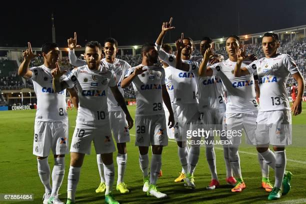 Ricardo Oliveira of Brazils Santos celebrates his goal with teammates scored against Colombias Santa Fe during their 2017 Copa Libertadores football...