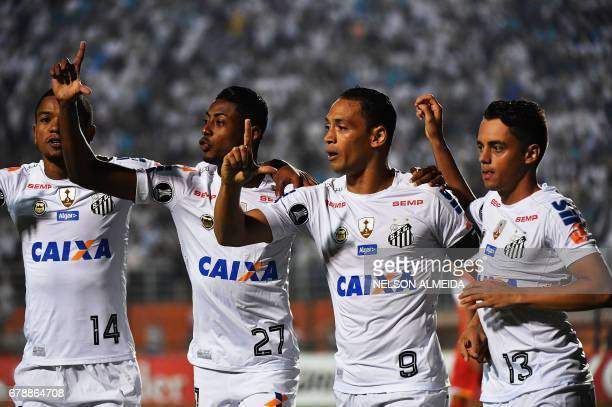 Ricardo Oliveira of Brazils Santos celebrates with teammates after scoring against Colombias Santa Fe during their 2017 Copa Libertadores football...