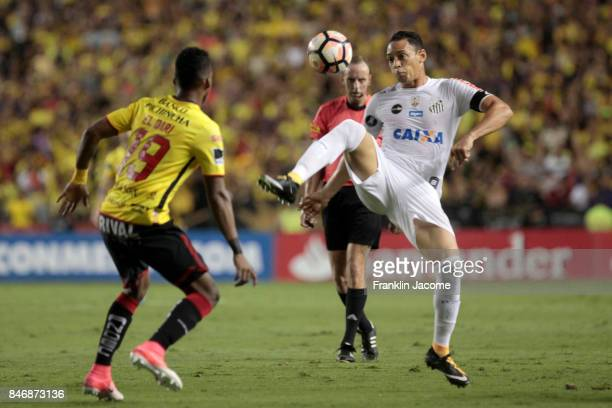 Ricardo Oliveira of Santos battles for the ball with Dario Aymar of Barcelona during a first leg match between Barcelona SC and Santos as part of...