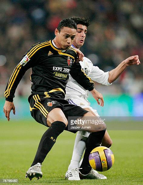 Ricardo Oliveira of Zaragoza duels for the ball with Miguel Torres of Real Madrid during the La Liga match between Real Madrid and Zaragoza at the...