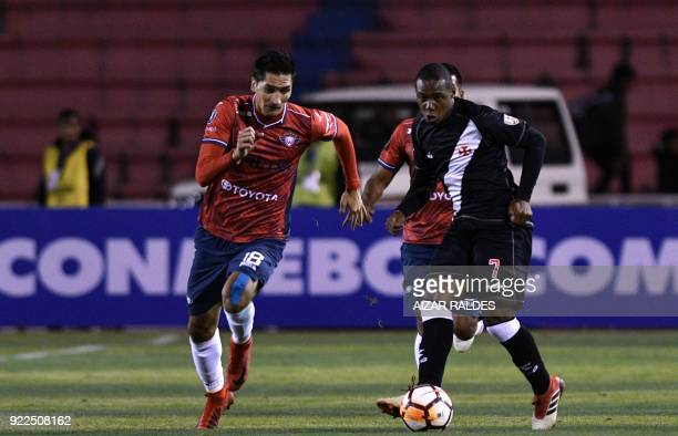 Ricardo Pedriel of Bolivia's Wilstermann vies for the ball with Wellington of Brazil's Vasco Da Gama during their Copa Libertadores football match at...