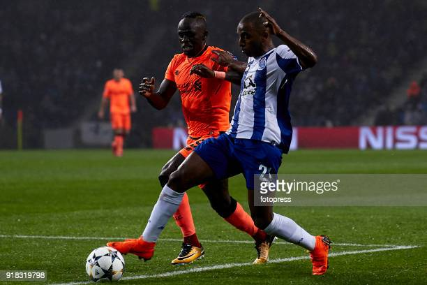Ricardo Pereira of FC Porto is challenged by Sadio Mane of Liverpool FC during the UEFA Champions League Round of 16 First Leg match between FC Porto...