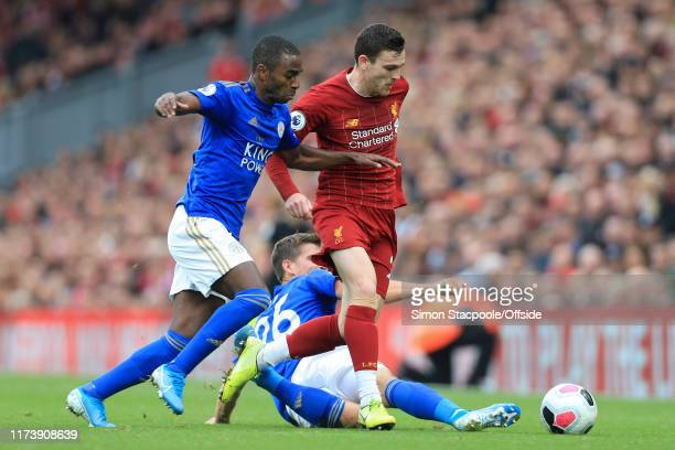 Ricardo Pereira of Leicester battles with Andrew Robertson of Liverpool during the Premier League match between Liverpool FC and Leicester City at...