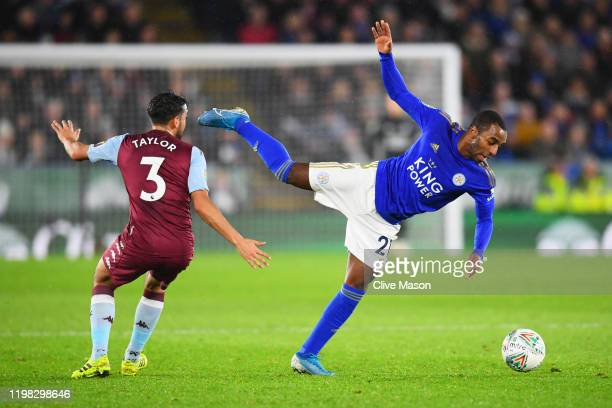 Ricardo Pereira of Leicester City battles for the ball with Neil Taylor of Aston Villa during the Carabao Cup Semi Final match between Leicester City...