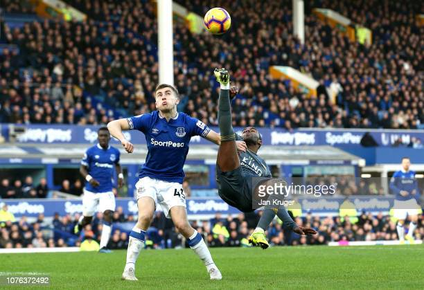 Ricardo Pereira of Leicester City crosses the ball as he is closed down by Jonjoe Kenny of Everton during the Premier League match between Everton FC...